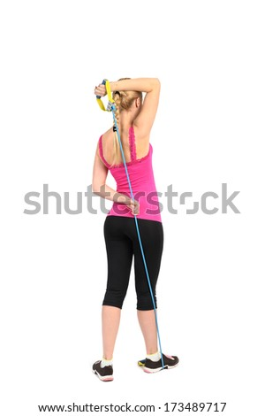 triceps extension exercise using rubber resistance band. position 1 of 2. - stock photo