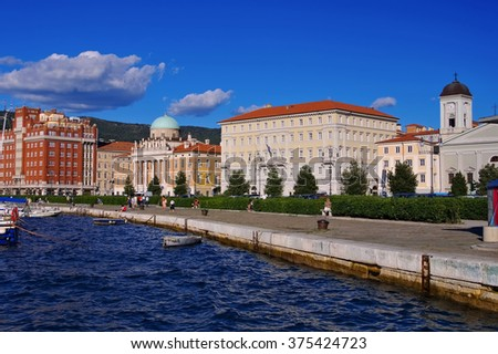 Trieste in Italy, pier and skyline - stock photo