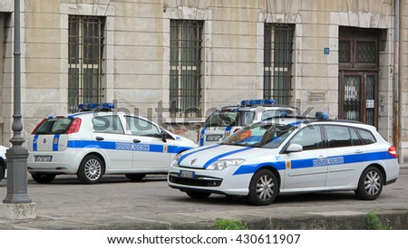 TRIESTE, ITALY - AUGUST 9, 2013: Local police cars (Polizia locale) parking near police station in Trieste. Port city is popular tourist destination, police often patrol for pocket thiefs. - stock photo