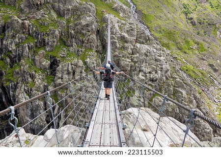Trift Bridge, pedestrian-only suspension bridge in Alps. Canton of Berne. Svitzerland  - stock photo