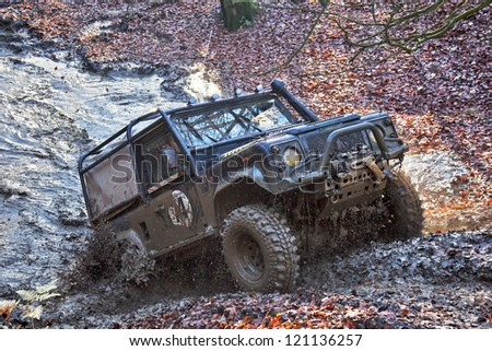 TRING, UK - NOVEMBER 25: An unnamed driver of the Burnham off road 4x4 club attempts to beat a specially designed off road 4x4 trials course during a club practice event on November 25, 2012 in Tring - stock photo
