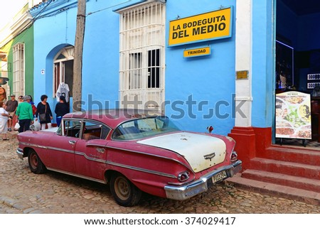 TRINIDAD, CUBA - JAN 19, 2016: Vintage Chevrolet Biscayne in front of La Bodeguita Del Medio in Trinidad, Cuba. This is a replica of the bar in Havana that is credited with the invention of the Mojito - stock photo