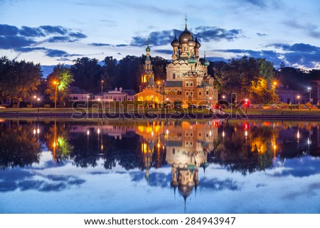 Trinity church reflecting in Ostankino pond in the evening, Moscow, Russia - stock photo