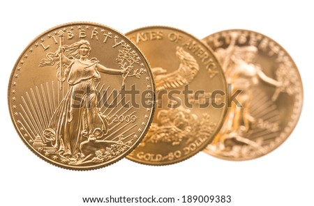 Trio of gold eagle one troy ounce golden coins from US Treasury mint - stock photo