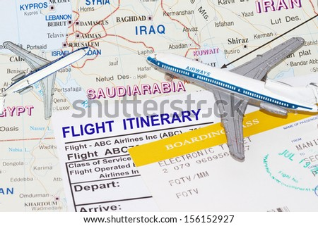 Trip to middle east with plane and flight itinerary - stock photo
