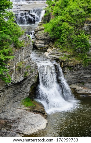 Triphammer Falls, Ithaca, New York. An urban waterfall in the middle of the Cornell University campus. - stock photo