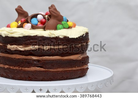 Triple Chocolate Nutella Easter Layer Cake, Easter decoration - stock photo