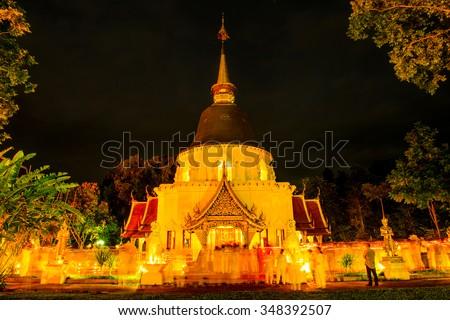 Triple Circumambulation of Visakha Bucha Day at Darabhirom Forest Monastery, Thailand. - stock photo