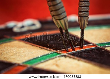 Triple 20' / Vintage style photo from three darts hit the triple sector of number 20 - stock photo