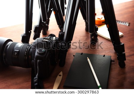 Tripods and DSLR camera. Ready for filming or photo session. Photography equipment.  - stock photo