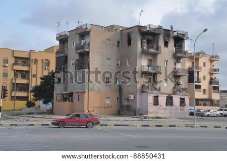 TRIPOLI, LIBYA - NOVEMBER 5. Anti Qaddafi graffiti on walls in the streets of Tripoli after the victory of the revolution fighters against Qaddafi, Tripoli, Libya, November 5, 2011 - stock photo