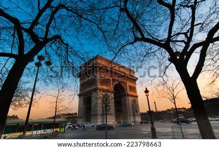 Triumphal Arch / Arc de Triomphe  at sunset, Paris, France - stock photo