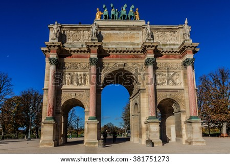 Triumphal Arch (Arc de Triomphe du Carrousel) at Tuileries gardens in Paris, France. Monument was built between 1806 - 1808 to commemorate Napoleon's military victories. - stock photo