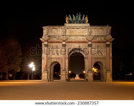Triumphal Arch (Arc de Triomphe du Carrousel) at Tuileries, Paris  - stock photo