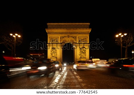 Triumphal Arch on the SDG square at night. Road out of focus. Blurred lighting traces of automobiles. - stock photo