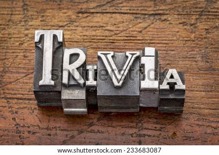 trivia word in vintage metal type printing blocks over grunge wood - stock photo