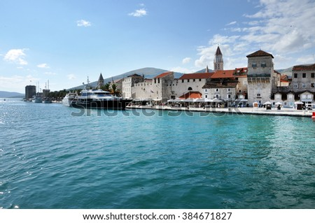 TROGIR, CROATIA - AUGUST 27, 2014: Luxurious yacht anchored in Trogir, Croatia. The port of the city is used by sailors to anchored due to its great position - stock photo