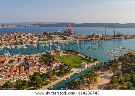 Trogir old town panorama with Kamerlengo Castle and shipyard in the background - stock photo