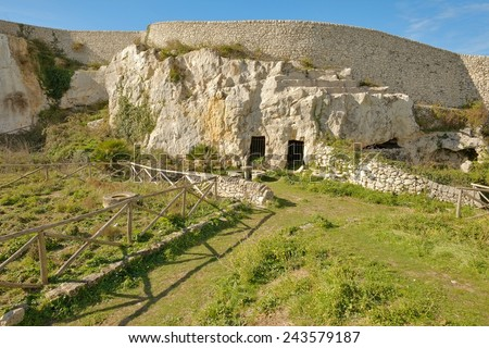 troglodyte dwellings in archaeological park of Akrai in Palazzolo Acreide, Sicily  - stock photo