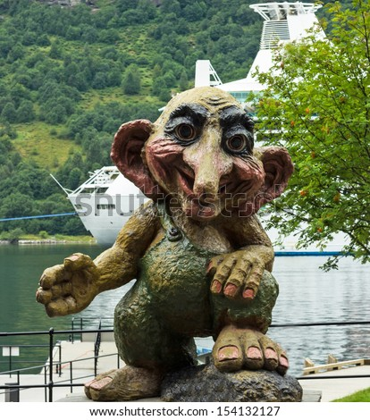 Troll monument in Geiranger, Norway. Trolls are evil personages of popular Scandinavian folklore. - stock photo