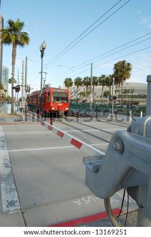Trolley crossing; San Diego, California - stock photo