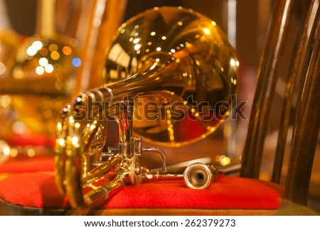 Trombone lying on a chair closeup - stock photo