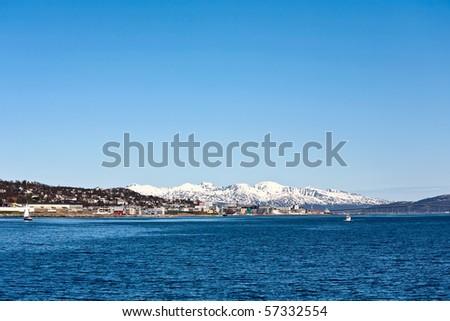 Tromso city from the sea - stock photo