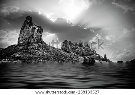 Trona pinnacles with water flooding the landscape. - stock photo