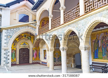 TROODOS, CYPRUS - AUGUST 2, 2014: The entrance to the Virgin Mary church of the Kykkos Monastery, surrounded by beautiful mosaic icons, on August 2 in Troodos. - stock photo