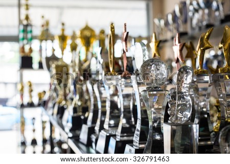Trophy awards for champion leadership in tournament - stock photo