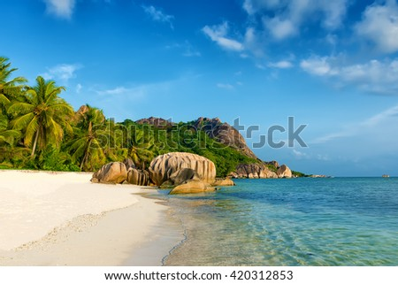 tropical anse source d'argent beach on la digue island in seychelles - stock photo