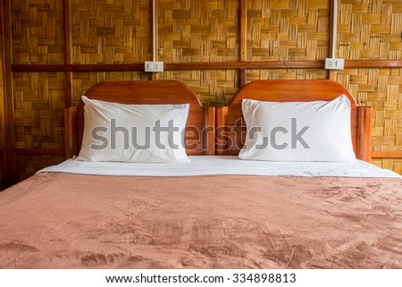 tropical asian style bedroom with bamboo wall - stock photo