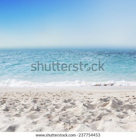 Tropical background with white sand beach, blue sea and perfect sky - stock photo