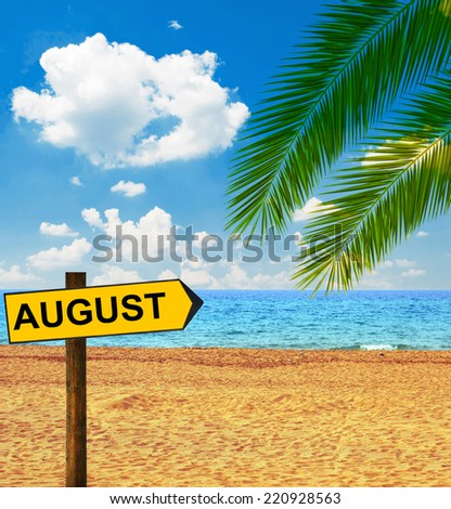 Tropical beach and direction board saying AUGUST - stock photo