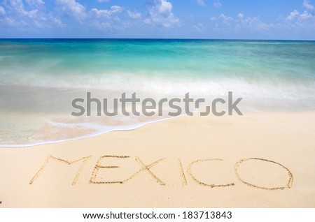 Tropical beach and Mexico writing on sand - stock photo