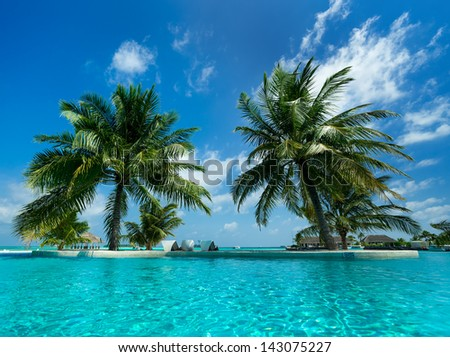 Tropical beach and pool - stock photo