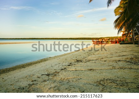 Tropical beach at sunrise, Cook Islands, Aitutaki. - stock photo