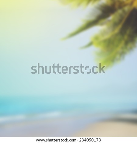 Tropical beach background with palm and blue sea - stock photo