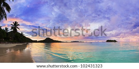 Tropical beach Cote d'Or at sunset, Seychelles - vacation background - stock photo