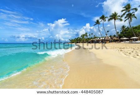 Tropical beach in Dominican Republic. - stock photo