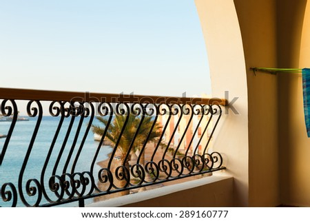 Tropical beach in Egypt seen from the balcony of hotel room - stock photo