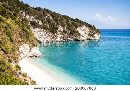 Tropical beach in the bay - stock photo