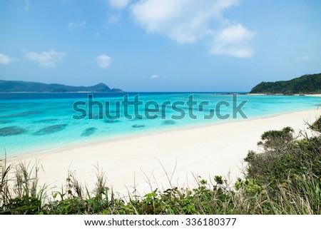 Tropical beach paradise and clear blue water of coral reef lagoon, Amami Oshima Island, Kagoshima, Japan - stock photo