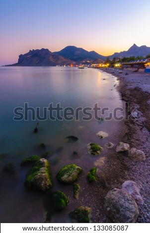 Tropical beach scenery with parasol - stock photo