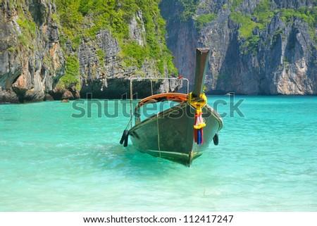 Tropical beach, traditional long tail boats, famous Maya Bay, Thailand - stock photo
