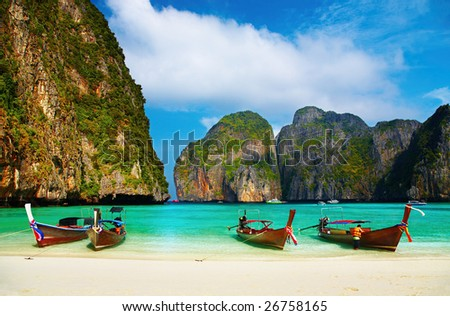 Tropical beach, traditional long tail boats, famous Maya Bay, Thailand - stock photo