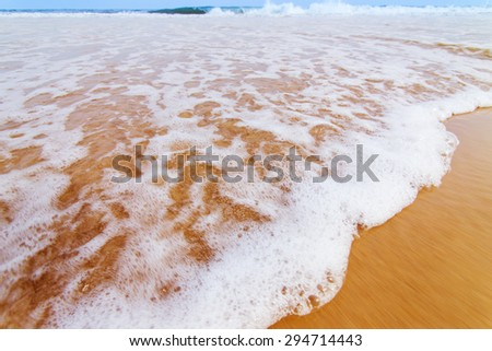 Tropical beach wave. Retro vintage post processed. Vacation travel, summer, Caribbean, lifestyle concept - stock photo