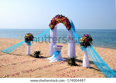 Tropical beach wedding. Beautiful wedding arch on the beach. - stock photo