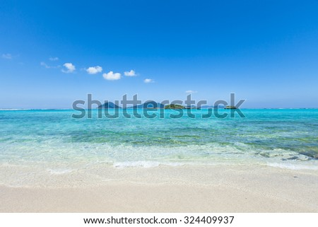 Tropical beach with clear water of a coral lagoon, Okinawa, Japan - stock photo