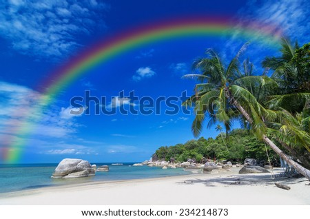 Tropical beach with sea on the sand and palm trees with rainbow, sa-mui island, thailand - stock photo